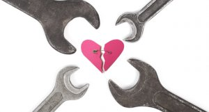 wrenches surrounding broken heart