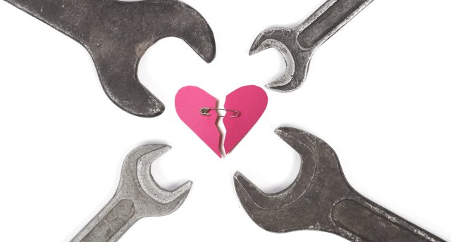 wrenches surrounding wounded heart